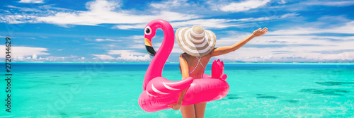 Happy summer vacation fun woman tourist enjoying travel holidays on beach banner background ready for swimming pool with flamingo float - funny holiday concept. - 272044629