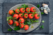 Cherry Tomatoes On Vine With H...