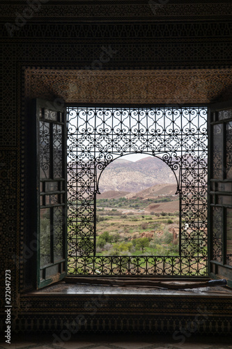 Canvas Prints Morocco Beautiful window looking out to a Moroccan village in the distance