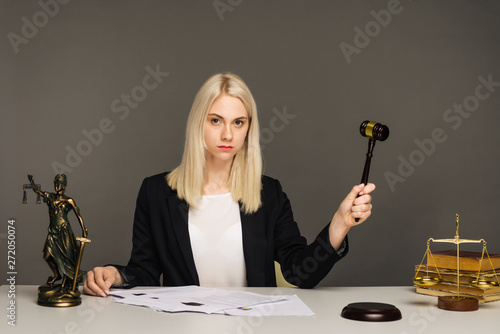 Fotografering Justice scales, justice hammer and Litigation document, female lawyer working legal law with use laptop at lawyer office
