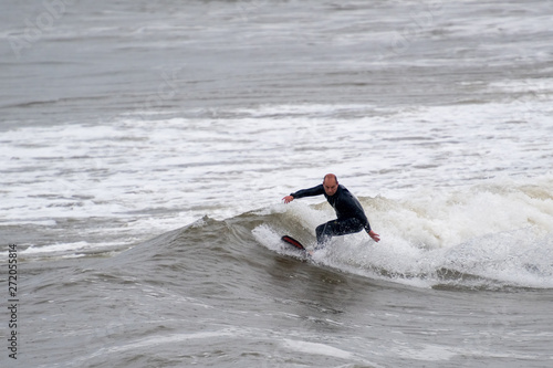 Male Surfing In Light Rain Buy This Stock Photo And