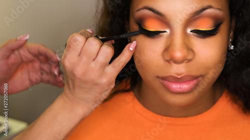 Fotografie, Obraz  Makeup artist apply mascara on lashes african american girl