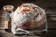 Leinwandbild Motiv Fresh loaf of bread with salt on wooden table