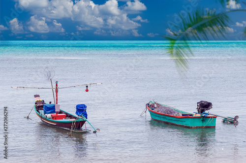 Fishing boats anchored at blue lagooon. Canvas-taulu