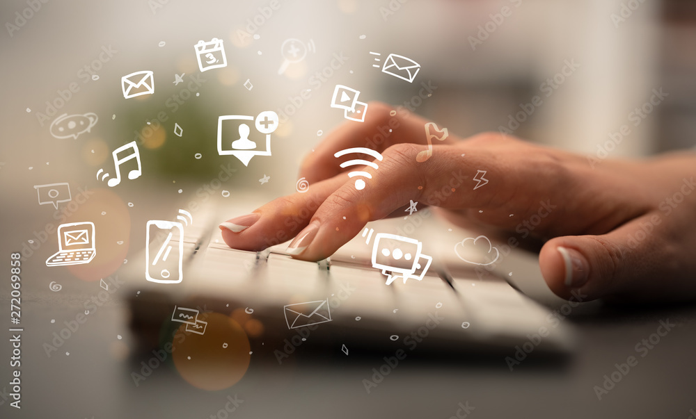 Fototapety, obrazy: Business woman hand typing on keyboard with drawn application icons around