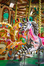 Decorated Wooden Animals On Carousel Attraction