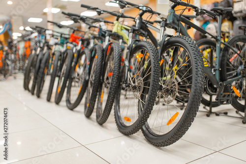 Photo  Rows of mountain bicycles in sports shop, nobody