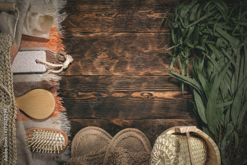 Fotografía Eucalyptus bath broom and other bathhouse accessories on a wooden table flat lay background with copy space