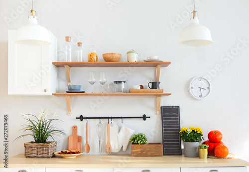 Valokuva  Interior of empty modern white kitchen with various objects