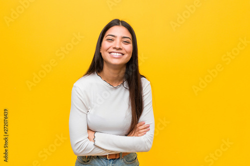 Obraz Young pretty arab woman against a yellow background laughing and having fun. - fototapety do salonu