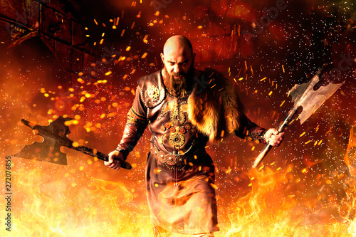 Photo Viking with axes in hands standing in fire