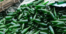 Whole And Broken Green Bottles, Lie Mountain On Pavement. Concept: Waste Recycling, Disposal Of Garbage And Glass Objects.