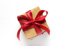Gift In Craft Pack With A Red Bow Top View. Holiday Surprise