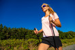 Leinwandbild Motiv Nordic walking - young woman training