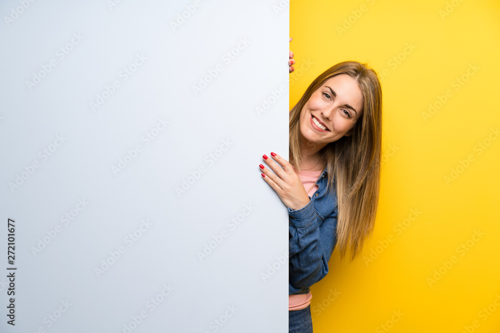 Fototapety, obrazy: Happy Young woman holding an empty placard