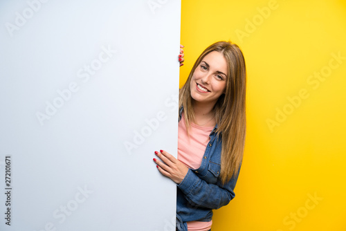 Fotografie, Obraz  Happy Young woman holding an empty placard