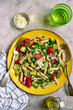 Penne pasta with vegetables : green pea, grilled bell pepper, tomato and zucchini. Top view with copy space.