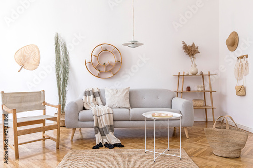 Stylish and cozy interior of living room with elegant rattan ...