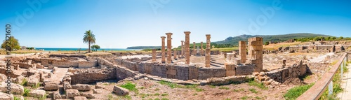 Fotografie, Obraz Panorama view of the ancient Romans ruins of Baelo Claudia, next to the beach of Bolonia, near Tarifa in Cadiz in the south of Spain