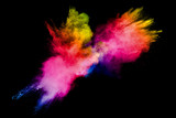 Fototapeta Tęcza - Colorful powder explosion on white background.Pastel color dust particle splashing.