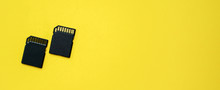 Closeup Top View Of Sd Memory Card On Yellow Bakground