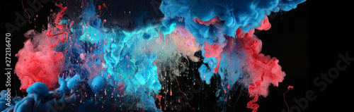 Acrylic blue and red colors in water. Ink blot. Abstract black background.
