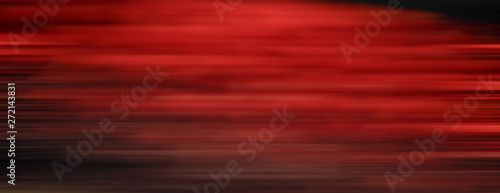 Fotografiet  Abstract red motion blur background