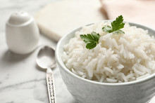 Bowl Of Tasty Cooked Rice With...