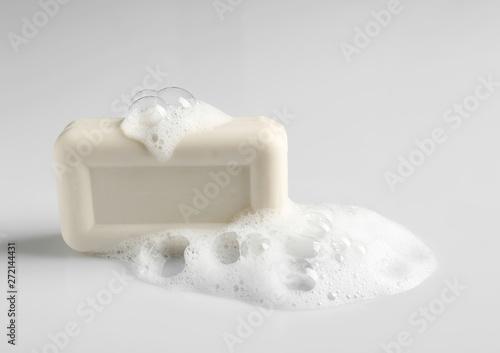 Valokuva Soap bar and foam on white background