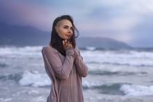 Young Woman At The Sea Coast Beach