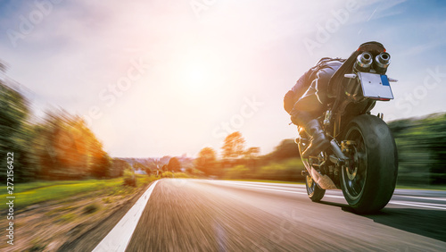Foto auf Leinwand Akt motorbike on the road riding. having fun riding the empty road on a motorcycle tour / journey