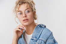 Close-up Elegant Good-looking Fashionable Blond Blue-eyed Blogger Wear Transparent Glasses Denim Jacket Touching Chin Thoughtful Look Camera Intrigued, Interested, Standing White Background