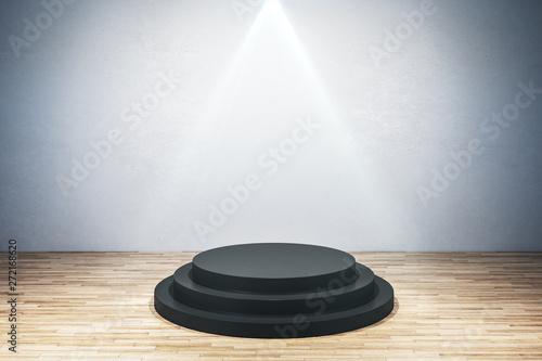 Fotografiet  Illuminated round black pedestal