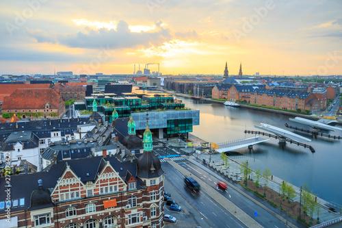 Photo  Sun is rising over the canal in Copenhagen, Denmark