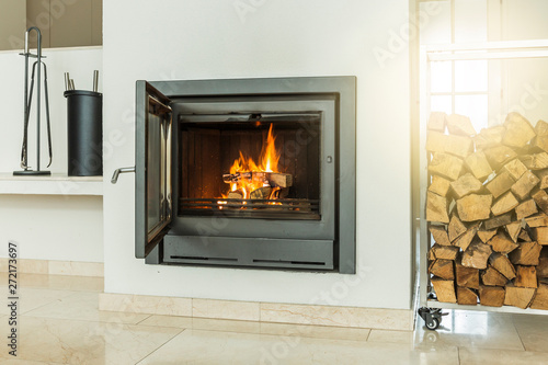 Luxurious modern design fireplace with glass door, white walls on yellow marble floor home interior