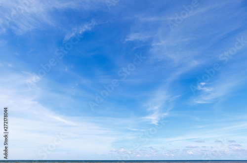 obraz lub plakat Beautiful blue sky over the sea with translucent, white, Cirrus clouds