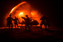 Artwork Decoration. Soldiers In The Desert During The Military Operation With Combat Helicopter Or Helicopter Assault Special Forces.