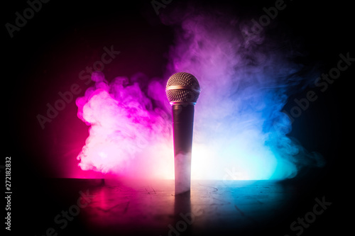Microphone karaoke, concert . Vocal audio mic in low light with blurred background. Live music, audio equipment. Karaoke concert, sing sound. Singer in karaokes, microphones. - 272182832
