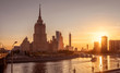 Moscow cityscape at sunset, Russia. Panorama of Moscow city with Radisson Royal Hotel at Moskva River in sun light. This old tall building is a landmark of Moscow. Sunny view of Moscow in summer.