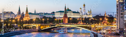 Moscow Kremlin at night, Russia. Panoramic view of the Moscow city center in summer. Moscow cityscape with Moskva River in evening. Panorama of old Moscow Kremlin and Bolshoy Kamenny Bridge at dusk.