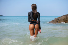Sexy Summer Outdoor Style Beach Sea Vacation Portrait Of Hot Tanned Back Of Beautiful Sporty Girl In Black Bikini And Shirt. Summer Vacation. Phuket. Thailand. Back View.