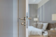 Door handle , door open in front of blur interior room background, selective focus