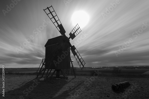 old windmill at sunset bland and white