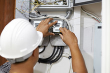 Electrician Is Repairing And Checking Electric Meters. Close Up. Selective Focus.