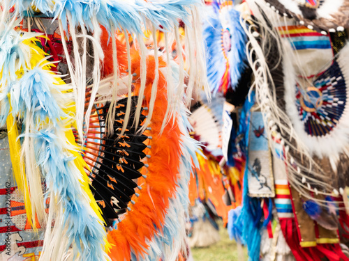 Fotomural Close Up of Quill and Orange, Blue and Yellow Feather Bustle at Pow Wow
