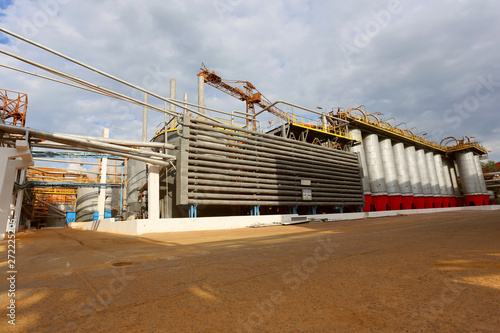 Storage tanks and pipes at alumina processing plant Wallpaper Mural