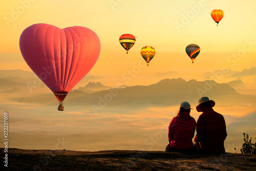 Foto auf AluDibond Melone People enjoyed sunrise at the mountain top with scenic view and hot air balloon.