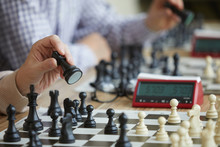 Two Chess Players Sitting In A...