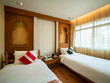 Luxury room with bed in warm light, India style,