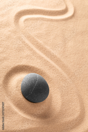 Tuinposter Stenen in het Zand Zen meditation Japanese stone and sand garden with raked line. Concept for concentration and focus for purity, harmony and balance. Background with copy space. .